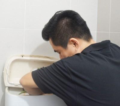 person-plumbing-repair